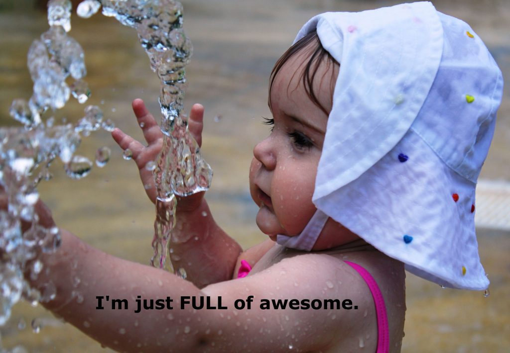 Picture of baby exploring water