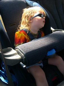 Asleep in a carseat.