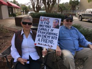 couple holding MLK love sign