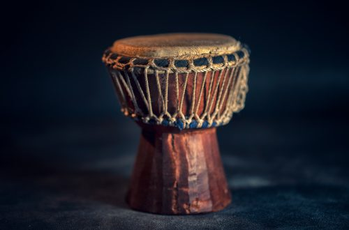 selective focus photography of brown djembe instrument