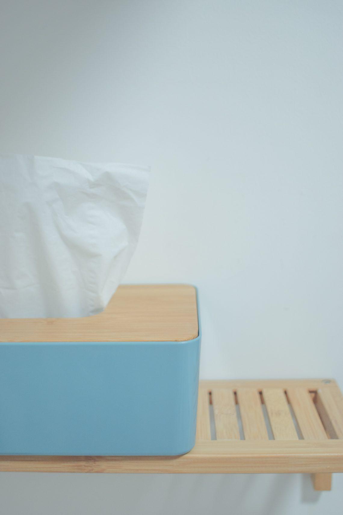 white tissue paper on blue plastic trash bin