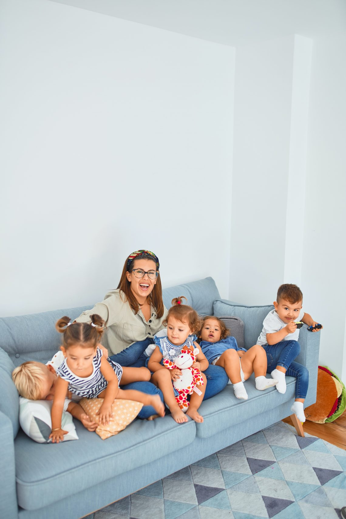 3 women sitting on gray couch