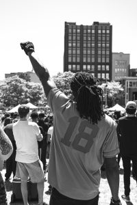 Back of African-American with fist raised