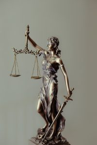 Gold colored statue of lady justice